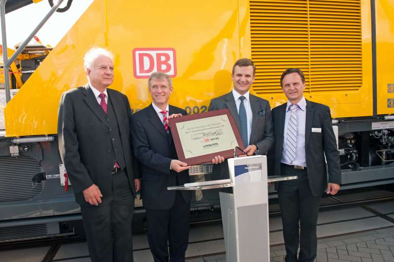 Handover of the new TIF tunnel inspection vehicle to DB Netz AG - both customers and suppliers were delighted: (f.l.t.r) Gerhard Polterauer (P&T), Roland Bosch (DB Netz AG Board Member for Operations), Johannes Max-Theurer and Jürgen Kübler (P&T).