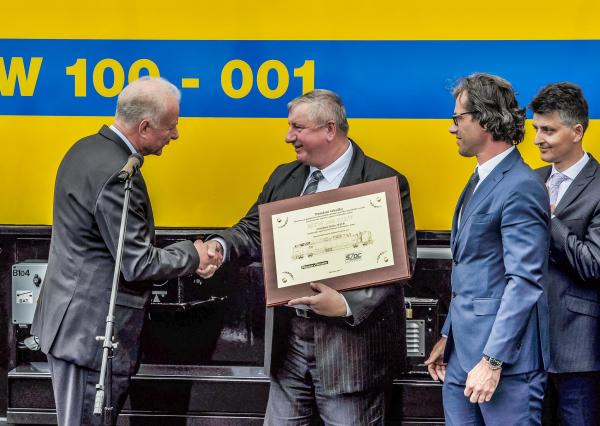 Handover ceremony – Gerhard Polterauer, Plasser & Theurer; Pavel Surý, Director General of SŽDC; Wolfgang König, Plasser & Theurer; Jiří Svoboda, Deputy Director General of SŽDC