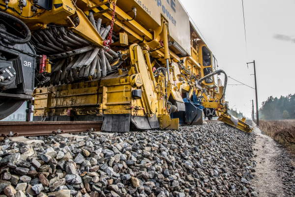 "The ""One Pass Technology"" makes it possible to distribute and profile ballast in one pass."