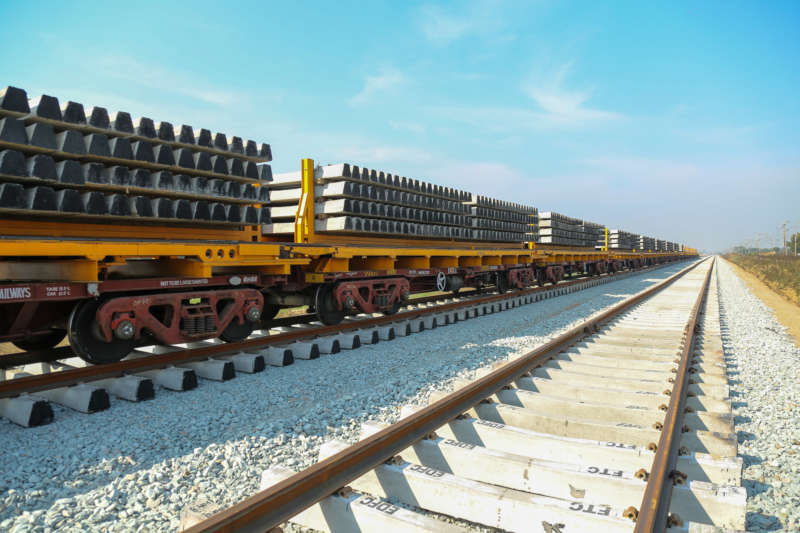 Flat wagons with the required sleepers and rails for the construction of the new track complete the construction train.