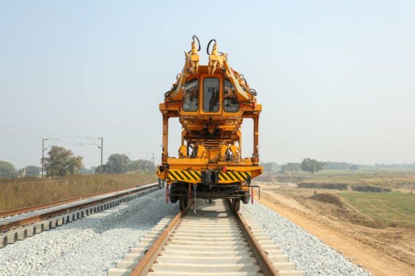 At the rear the machine travels on the newly laid track.