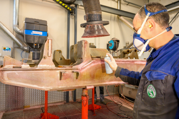 A local speciality: revitalising the running technology. A Framafer technician checks a sandblasted bogie for cracks.