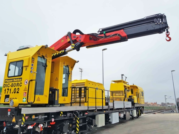 It has a crane and a loading platform for transporting material
