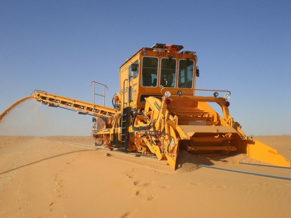 The SRM 500, sand removal machine removing sand from tracks in Saudi Arabia